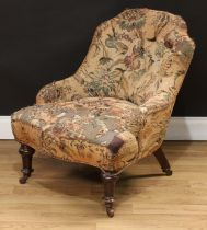 A Victorian low club or drawing room chair, shaped button back, serpentine seat, turned forelegs,