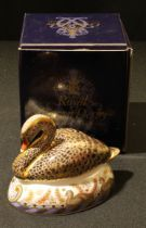 A Royal Crown Derby paperweight, Golden Jubilee Black Swan, limited edition 1069/2,002, gold