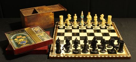 A novelty chess set, plastic figural pieces in medieval dress, a marquetry inlaid chess board; a
