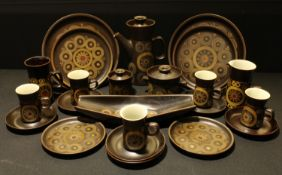 A Denby Arabesque pattern part dinner and coffee service, including dinner plates, cups and saucers,