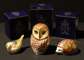 A Royal Crown Derby paperweight, Barn Owl, gold stopper, boxed; others, Orchard Hedgehog, gold