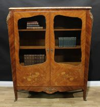 A Louis XV style gilt metal mounted kingwood and marquetry bookcase, marble top above a pair of