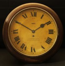 Police Station Wall Clock by TA Henn & Son, Wolverhampton. Circular dial with Roman numerals alomg