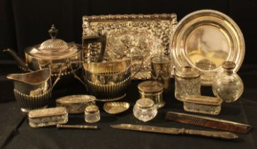 A silver topped scent bottle, Birmingham 1909; a silver capstan shaped dressing table box, Chester