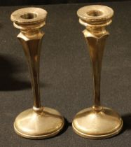 A pair of silver dressing table candlesticks, Chester 1931, hollow filled, 17.5cm