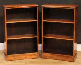 A pair of mahogany open bookcases, of small proportions, each with a moulded rectangular top above