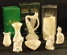 A Belleek Dragonfly pattern vase, 18cm, printed mark, boxed; others similar, a Harp, boxed; cats,