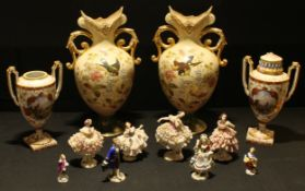 A pair of late Victorian blush ground mantel vases, decorated with birds, flowers and foliage,