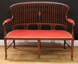 An Edwardian mahogany and marquetry sofa, shaped cresting rail inlaid with an oval batwing patera