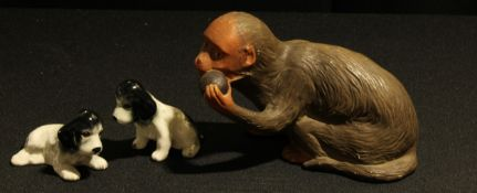 A Bretby monkey, pattern No. 2787, and two Sylvac 'Spaniel Puppy' figurines, (3).
