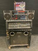 A Kustom 250 amplifier; similar speaker; a Philips Tandem portable stereo.