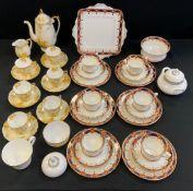 A Paragon six setting tea service; a Roslyn six setting crocus coffee service, etc