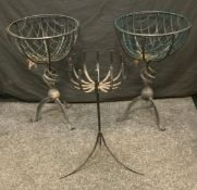 A pair of circular wirework basket planters, spiral vortex column, tripod feet, 64.5cm high, 43cm