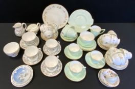 A Royal Worcester tea service, for six, printed with flowers; another, Wedgwood Mirabelle; a