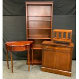 A reproduction mahogany demi-lune side table, half gallery above a single cockbeaded drawer,