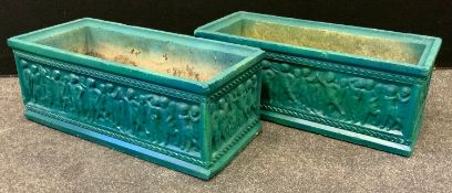 A pair of rectangular reconstituted stone planters, relief cast with figures, 62cm long, 28cm