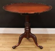 A 19th century mahogany tripod occasional table, shaped circular top with pie-crust edge, stop-