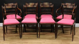 A set of eight Regency simulated rosewood and brass marquetry dining chairs, each with a shaped