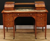 A late Victorian Sheraton Revival mahogany and marquetry writing desk, shaped superstructure with