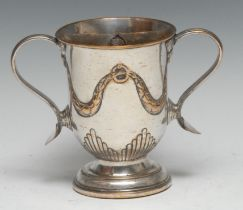A George III Old Sheffield Plate loving cup, hal-fluted and chased with swags, scroll handles with