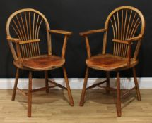 A pair of 19th century sheaf-back elbow chairs, of Windsor chair construction, hoop backs, saddle