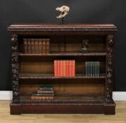 A late Victorian oak library open bookcase, rectangular top with leafy moulded edge above two