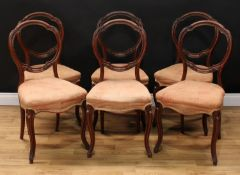 A set of six Victorian mahogany balloon back dining chairs, each with a shaped moulded back carved