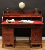 A George III mahogany tambour front twin pedestal desk, three quarter gallery and retractable