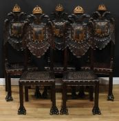A set of five South European parcel-gilt dining chairs, each back carved with a Habsburg double-