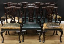 A set of ten Chippendale Revival mahogany dining chairs, comprising a pair of carvers and eight side