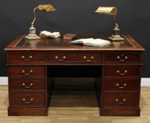 A Victorian mahogany twin pedestal partners' desk, rectangular top with tooled and gilt writing