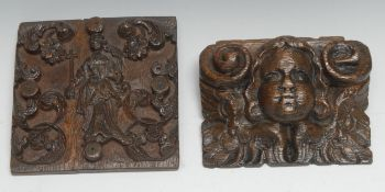 A 17th century oak panel, carved in relief with St Helena and attributes, flanked by flowering