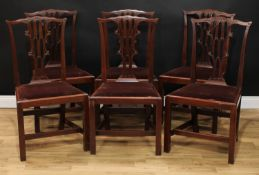 A set of six Chippendale Revival mahogany dining chairs, each with a shaped cresting rail above a