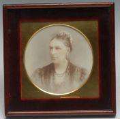 English School, 19th century, a portrait miniature, of a lady wearing a floral bonnet, sepia,