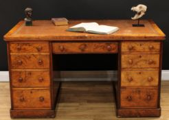 A Victorian burr walnut partner's desk, rounded rectangular top with inset tooled and gilt leather