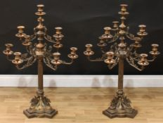 A pair of substantial Empire style bronze ten-light table candelabra, beaded campana sconces, the