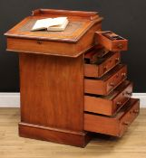 A Victorian mahogany Davenport desk, hinged sloping writing surface enclosing two small drawers, the