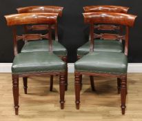 A set of four Regency dining chairs, curved cresting rails, lozenge shaped mid rails, stuffed over