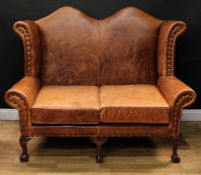 A George II inspired wingback sofa or double wing chair, studded stuffed-over upholstery, squab