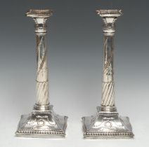 A pair of George III Old Sheffield Plate table candlesticks, of Adam design, incurved canted