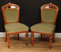 A pair of Victorian walnut and marquetry side chairs, each with shaped cresting rail carved with a