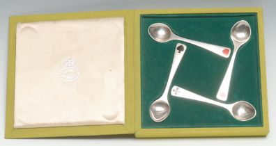 Georg Jensen - a set of four Danish silver and enamel spoons, each enamelled with one of the four