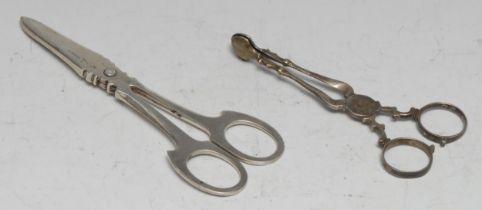 A pair of mid-18th century silver sugar nips, 11.5cm long, maker IG, c.1750; a pair of German silver