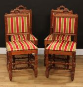 A set of four Cromwellian Revival oak dining chairs, each with a rectangular back with architectural