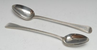 A pair of George III Old English bead pattern basting spoons, 30.5cm long, William Eley, William