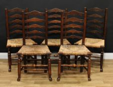 A set of five 19th century Lancashire ladder back 'regional' chairs, each with rush seats, turned