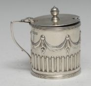 A Victorian Adam Revival silver drum mustard, half-fluted and chased with swags and pendants, hinged