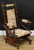A late 19th century child's American spring rocking chair, traditionally ring-turned throughout,