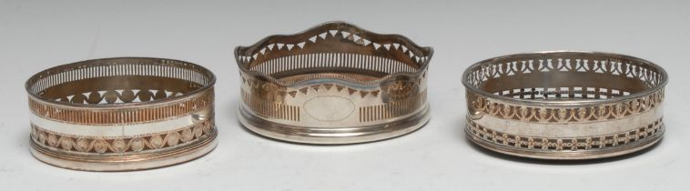 A George III Old Sheffield Plate wine coaster, pierced and engraved in the Neo-Classical taste,