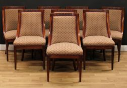 A set of eight Empire design mahogany dining chairs, curved backs carved and applied with bosses,